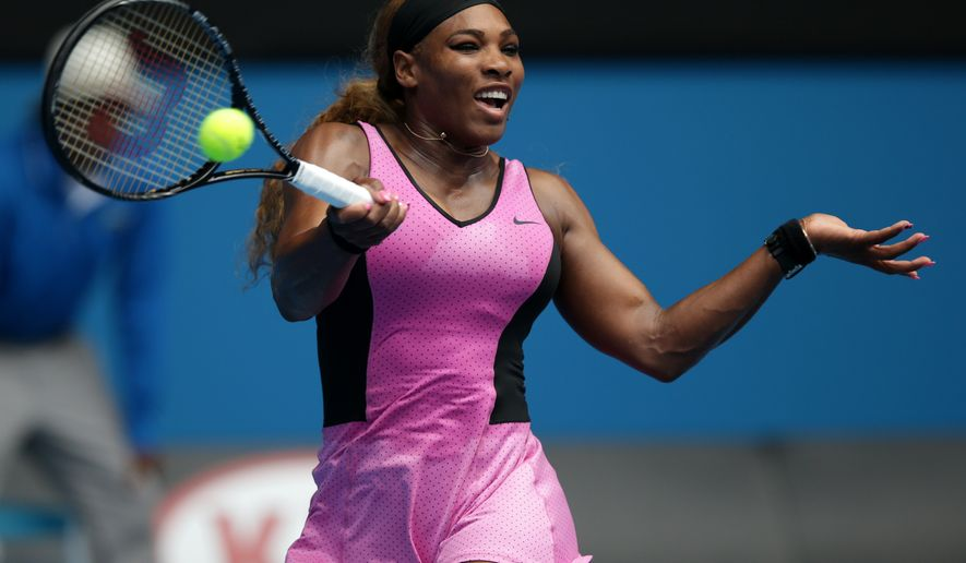 Serena Williams of the United States makes a forehand return to Vesna Dolonc of Serbia during their second round match at the Australian Open tennis championship in Melbourne, Australia, Wednesday, Jan. 15, 2014.(AP Photo/Aaron Favila)