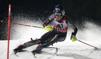 Mikaela Shiffrin, of the United States, competes on her way to set the fastest time during the first run of an alpine ski, women's World Cup slalom in Flachau, Austria, Tuesday, Jan. 14, 2014. (AP Photo/Marco Trovati)
