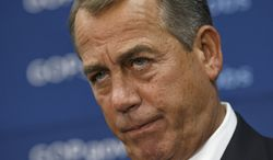 House Speaker John Boehner of Ohio, and GOP leaders face reporters on Capitol Hill in Washington, Tuesday, Jan. 14, 2014, after a weekly House Republican Conference meeting. The Republicans tied the recent stagnant employment reports to the policies of President Barack Obama and Democratic lawmakers.  (AP Photo/J. Scott Applewhite)