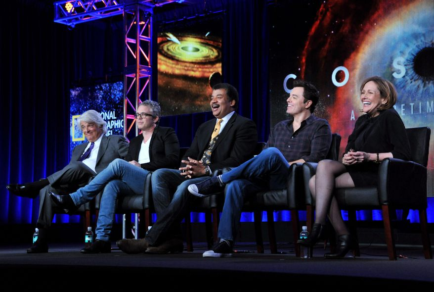 """Executive producer, from left, Mitchell Cannold, executive producer Brannon Braga, host Neil DeGrasse Tyson, executive producer Seth MacFarlane, and writer Ann Druyan participate on a panel for """"Cosmos"""" at the FOX Winter 2014 TCA, on Monday, Jan. 13, 2014, at the Langham Hotel in Pasadena, Calif. (Photo by Richard Shotwell/Invision/AP)"""