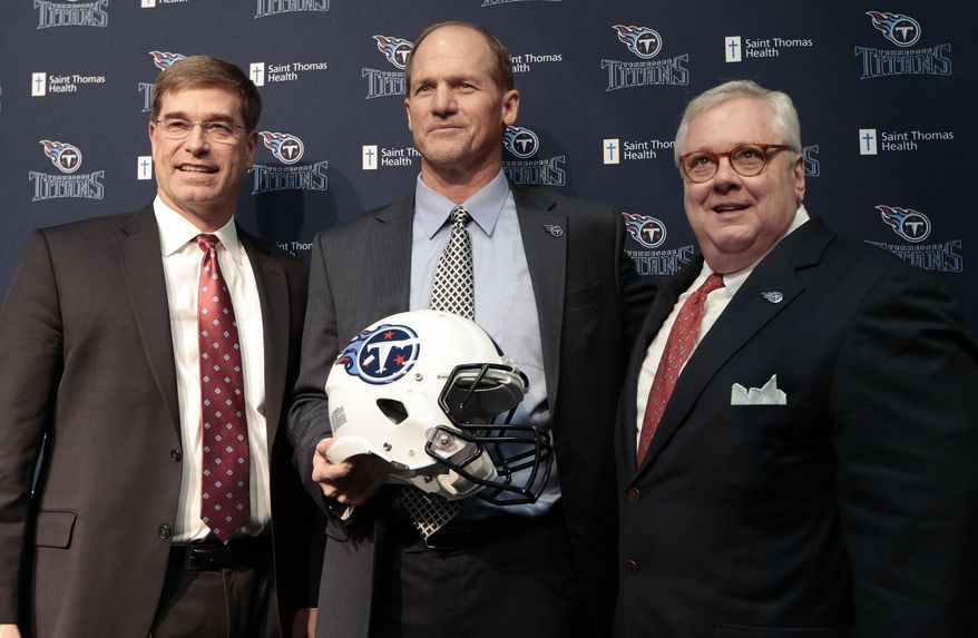 Tennessee Titans coach Ken Whisenhunt, center, poses for pictures with general manager Ruston Webster, left, and president and CEO Tommy Smith at a news conference Tuesday, Jan. 14, 2014, in Nashville, Tenn. The Titans introduced Whisenhunt as their 17th head coach and only their third different coach since moving from Houston to Tennessee. (AP Photo/Mark Humphrey)