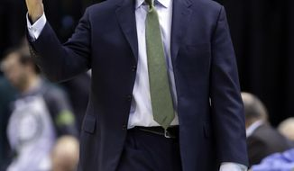 Indiana Pacers head coach Frank Vogel signals to his team as they played the Sacramento Kings in the second half of an NBA basketball game in Indianapolis, Tuesday, Jan. 14, 2014. The Pacers defeated the Kings 116-92. (AP Photo/Michael Conroy)