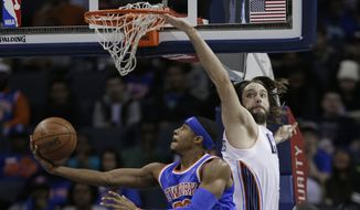 New York Knicks' Toure' Murry, front, drives past Charlotte Bobcats' Josh McRoberts during the first half of an NBA basketball game in Charlotte, N.C., Tuesday, Jan. 14, 2014. (AP Photo/Chuck Burton)
