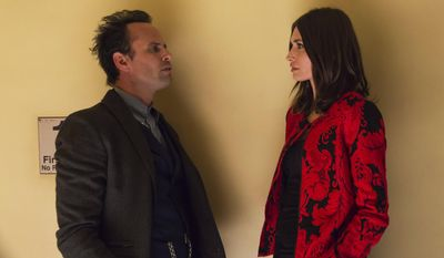"This photo released by FX Networks shows, Walton Goggins, left, as Boyd Crowder, and Karolyna Wydra as Mara, in a scene from the FX TV series ""Justified,""  airing Tuesdays, 10:00 p.m. ET/PT. Now in its fifth season, the show will end after season six, the producers and FX said Tuesday, Jan. 14, 2014.  (AP Photo/FX, Prashant Gupta)"