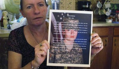 FILE-In this May 1, 2013 file photo shows Lori Ballman holding a tribute to her late daughter, Deanna, at her home in Pataskala, Ohio. Defense attorney Sam Shamansky  argued Tuesday, Jan. 14, 2014 that Ali Salim, an ex-Ohio doctor, was sentenced too harshly for his convictions on charges of raping Deanna Ballman and causing her death through a fatal heroin overdose. (AP Photo/Andrew Welsh-Huggins, File)