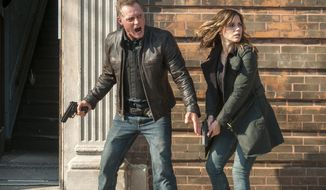 "This image released by NBC shows Jason Beghe as Detective Sgt. Hank Voight, left, and Sophia Bush as Erin Lindsay in a scene from ""Chicago P.D."" Centered on the Chicago Police Department's scrappy Intelligence Unit, the series by Dick Wolf pits Voight and his team against the worst killers, drug traffickers and mobsters the Windy City can deliver. The series airs Wednesdays at 10 p.m. on NBC. (AP Photo/NBC, Matt Dinerstein)"