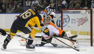 Buffalo Sabres center Cody Hodgson (19) moves around Philadelphia Flyers goaltender Steve Mason (35) for a goal during the first period of an NHL hockey game in Buffalo, N.Y., Tuesday, Jan. 14, 2014. (AP Photo/Gary Wiepert)