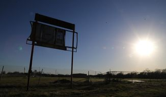 The sun sets near the old high school baseball scoreboard where former pro baseball player Scott Podsednik played in high school, Tuesday, Jan. 14, 2014 in, West, Texas. Podsednik, a West native, was part of a Texas Rangers caravan traveling through central Texas. West was devastated by a deadly fertilizer plant explosion last year. The Rangers have donated $50,000 to help renovate a park across from the plant site with a new playground and a memorial to the 15 people killed in the explosion. (AP Photo/Waco Tribune Herald, Rod Aydelotte)