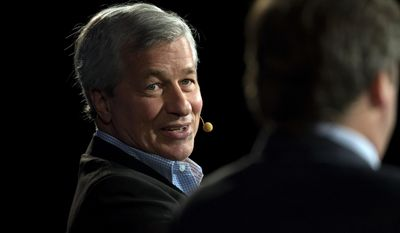 In this photo provided by the Robin Hood Foundation, Jamie Dimon, Chairman of the Board and Chief Executive Officer of JPMorgan Chase & Co., speaks at the inaugural Robin Hood Investors Conference in New York, Friday, Nov. 22, 2013. JPMorgan Chase & Co. reports quarterly financial results before the market opens on Tuesday, Jan. 14, 2014. (AP Photo/Robin Hood Foundation, Craig Warga)
