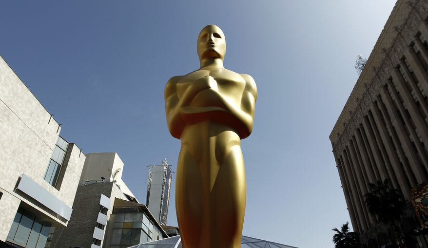 FILE - In this Feb. 25, 2012 file photo, a Oscar statue is seen on the red carpet before the 84th Academy Awards in Los Angeles. The producers of the 86th annual Academy Awards say this year's ceremony will honor big-screen, real-life heroes, superheroes, popular heroes and animated heroes, both past and present, as well as the filmmakers who bring them to life. Craig Zadan and Neil Meron said Tuesday, Jan. 14, 2014, that they wanted to unify the March 2 show with an entertaining and emotional theme.  (AP Photo/Matt Sayles, File)