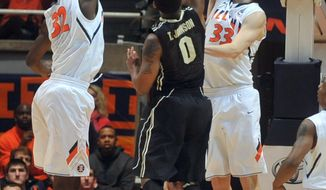 Illinois' Nnanna Egwu (32) and Jon Ekey (33) defend a shot by Purdue's Terone Johnson during the first half of an NCAA college basketball game Wednesday, Jan. 15, 2014, in Champaign, Ill. (AP Photo/Rick Danzl)