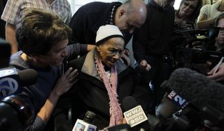FILE-- In this April 4, 2012 file photo, Texana Hollis thanks volunteers for fixing her home in Detroit. Hollis, who got her home back in 2012, at the age of 101, after being evicted because of foreclosure, has died. She was 103.  (AP Photo/Carlos Osorio)