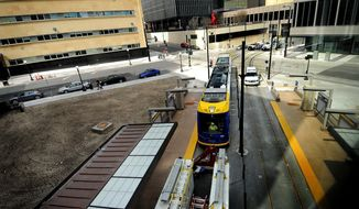 FILE - In this April 28, 2013 file photo the first light rail train car, not yet running on its own power, is pulled into the central station during its inaugural run on the Central Corridor Green Line in St. Paul, Minn.  Gov. Mark Dayton, speaking on construction project wishes Wednesday, Jan. 15, 2014, chose not to include any funding for the next hoped-for leg in the Minneapolis-St. Paul light rail system, connecting downtown Minneapolis to western suburbs. (AP Photo/St. Paul Pioneer Press, Sherri LaRose-Chiglo, File)