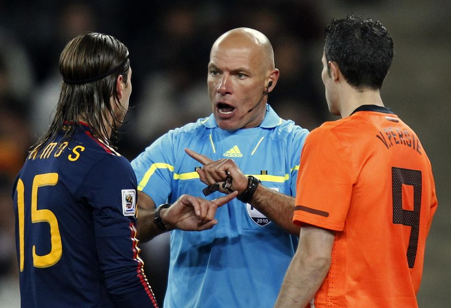 FILE - In this Sunday, July 11, 2010 file photo, referee Howard Webb of England, center, speaks with Spain's Sergio Ramos, left, and Netherlands' Robin van Persie during the World Cup final soccer match between the Netherlands and Spain at Soccer City in Johannesburg, South Africa. FIFA selected World Cup final referee Howard Webb on Wedensday Jan. 15, 2014, as one of the 25 who will officiate at the 2014 tournament in Brazil. (AP Photo/Luca Bruno, File)