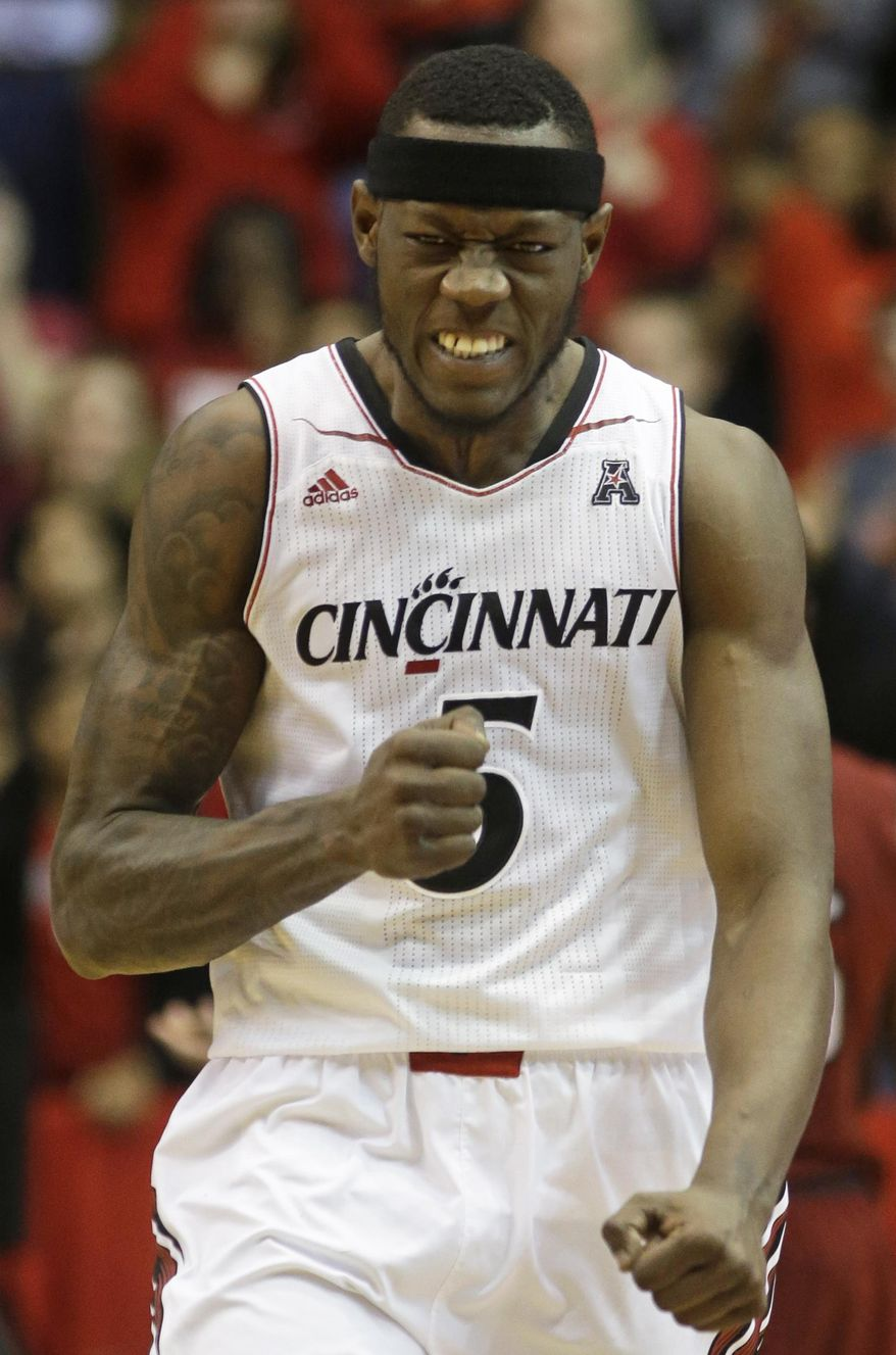 Cincinnati forward Justin Jackson clenches his fist after the Bearcats scored against Temple in the second half of an NCAA college basketball game, Tuesday, Jan. 14, 2014, in Cincinnati. Jackson had 15 points, 10 rebounds, and six blocked shots in the game won by Cincinnati 69-58. (AP Photo/Al Behrman)