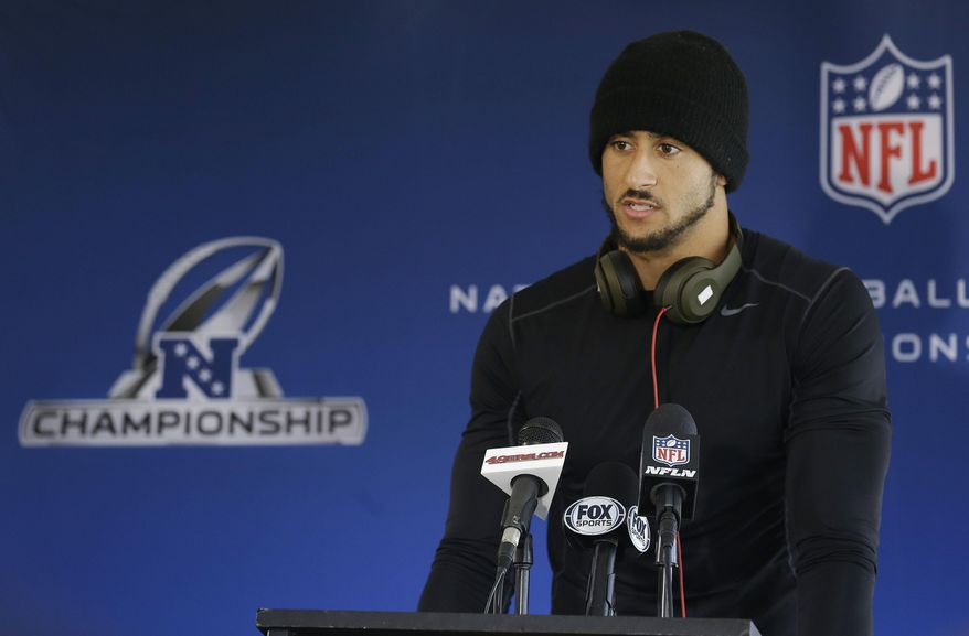 San Francisco 49ers quarterback Colin Kaepernick speaks to reporters at an NFL football training facility in Santa Clara, Calif., Wednesday, Jan. 15, 2014. The 49ers are scheduled to play the Seattle Seahawks for the NFC Championship on Sunday. (AP Photo/Jeff Chiu)