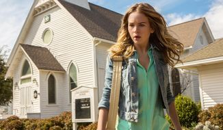"This undated publicity photo released by CBS Entertainment shows Britt Robertson, as Angie, in a scene from the pilot of the TV series ""Under the Dome."" CBS is establishing a special unit to develop miniseries and special live programs, an illustration of changing tastes in television. CBS entertainment president Nina Tassler said Wednesday, Jan. 15, 2014, that the new effort is being done in the wake of the miniseries ""Under the Dome"" last summer.  (AP Photo/CBS Entertainment, Michael Tackett)"