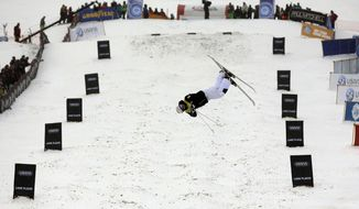 Canada's Mikael Kingsbury competes in the men's freestyle World Cup moguls event Wednesday, Jan. 15, 2014, in Wilmington, N.Y. (AP Photo/Mike Groll)