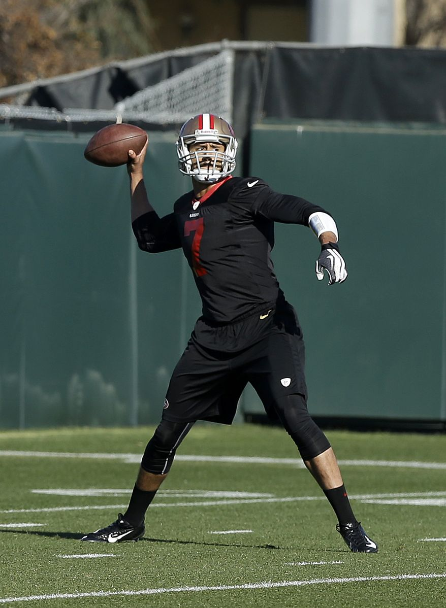 San Francisco 49ers quarterback Colin Kaepernick (7) practices at an NFL football training facility in Santa Clara, Calif., Wednesday, Jan. 15, 2014. The 49ers are scheduled to play the Seattle Seahawks for the NFC Championship on Sunday. (AP Photo/Jeff Chiu)