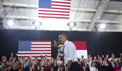 President Barack Obama waves to cheering audience members as he leaves the stage after speaking about the economy, jobs and manufacturing, Wednesday, Jan. 15, 2014, at North Carolina State University in Raleigh, N.C. (AP Photo/Carolyn Kaster)