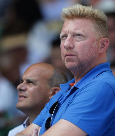 Former Grand Slam champion Boris Becker of Germany looks down onto Rod Laver Arena as he watches defending champion Novak Djokovic of Serbia in his match against Leonardo Mayer of Argentina at the Australian Open tennis championship in Melbourne, Australia, Wednesday, Jan. 15, 2014.(AP Photo/Aaron Favila)