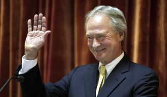 Rhode Island Gov. Lincoln Chafee waves at the conclusion of his State of the State address in the House chambers of the Statehouse, Wednesday, Jan. 15, 2014 in Providence. The annual speech traditionally sets out a governor's priorities for the year. It is Chafee's fourth and final such address. (AP Photo/Steven Senne)