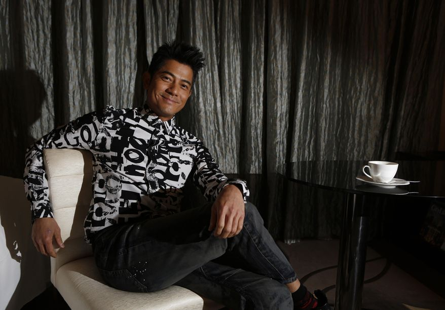 """In this Friday, Jan. 10, 2014 photo, Hong Kong veteran actor and performer Aaron Kwok poses during an interview in Hong Kong. Aaron Kwok says he brought out a softer side of a classic villain, the Bull Demon King. Kwok plays the character in the new 3-D fantasy film, """"The Monkey King."""" He joins a stellar ensemble cast that includes other A-listers like Donnie Yen, Chow Yun Fat, and Kelly Chan. (AP Photo/Kin Cheung)"""