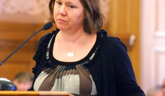 Jennifer Roth of the Kansas Association of Criminal Defense Lawyers, testifies about proposed changes to the Kansas murder statutes during a Senate committee hearing Wednesday, Jan. 15, 2014, in Topeka, Kan. Legislators are considering amending the penalty for premeditated first-degree murder to mandate a minimum 50 years to life in prison. (AP Photo/John Milburn)