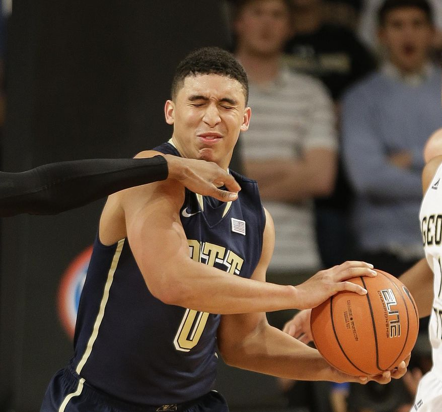Pittsburgh guard James Robinson takes a hand to the face in the second half of an NCAA college basketball game against Georgia Tech, Tuesday, Jan. 14, 2014, in Atlanta. (AP Photo/John Bazemore)