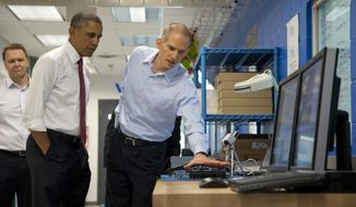 President Barack Obama tours Vacon, a research and development center and lab for high-power AC drives, with Vacon Vice President Dan Isaksson, left, and Vacon engineer Rod Washington, right, Wednesday, Jan. 15, 2014, in Durham, N.C., before traveling to North Carolina State University where he will speak about the economy, jobs and manufacturing.  (AP Photo/Carolyn Kaster) **FILE**