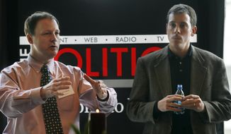 John Harris (left), editor in chief of Politico, and Jim VandeHei, executive editor, speak to advertisers in Arlington, Va., on Jan. 19, 2007. (Associated Press)