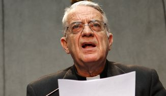 **FILE** Vatican spokesman Rev. Federico Lombardi makes an announcement during a press conference at the Vatican, Friday, July 5, 2013. (AP Photo/Riccardo De Luca)