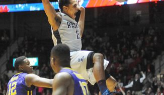 "Mississippi's Sebastian Saiz (11) dunks against LSU's Jarell Martin (12) and Andre Stringer (10) during an NCAA college basketball game at the C.M. ""Tad"" Smith Coliseum in Oxford, Miss., Wednesday, Jan. 15, 2014. (AP Photo/Oxford Eagle, Bruce Newman)"