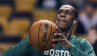 Boston Celtics guard Rajon Rondo takes a shot prior to the Celtics' NBA basketball game against the Toronto Raptors, in Boston on Wednesday, Jan. 15, 2014. Rondo took a step toward returning to action on Wednesday, working out with members of Boston's NBA Development League team at the Celtics' practice facility earlier in the day. (AP Photo/Charles Krupa)