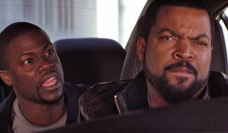 "This image released by Universal Pictures shows Ice Cube, right, and Kevin Hart in a scene from ""Ride Along."" (AP Photo/Universal Pictures)"