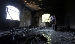 ** FILE ** This Sept 13, 2012, file photo shows the inside of the U.S. Consulate in Benghazi, Libya, after an attack that killed four Americans, including Ambassador J. Christopher Stevens. (AP Photo/Mohammad Hannon, File)