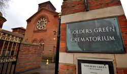The entrance to Golders Green Crematorium is seen in London, Wednesday, Jan. 15, 2014. Police are hunting burglars who tried to steal the ashes of psychoanalyst Sigmund Freud from the crematorium. The Metropolitan Police force says a 2,300-year-old Greek urn containing the remains of Freud and his wife Martha was severely damaged in a break-in at Golders Green Crematorium on Dec. 31 or Jan. 1. (AP Photo/PA, John Stillwell)