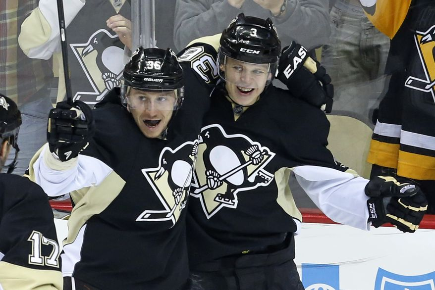 Pittsburgh Penguins' Olli Maatta (3) celebrates his goal with teammate Jussi Jokinen (36) in the third period of an NHL hockey game against the Washington Capitals in Pittsburgh, Wednesday, Jan. 15, 2014. The Penguins won 4-3. (AP Photo/Gene J. Puskar)