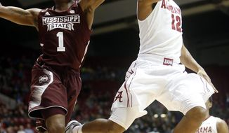 Alabama's Trevor Releford (12) takes the ball to the basket while under pressure by Mississippi State's Fred Thomas (1) during an NCAA college basketball game, Wednesday, Jan. 15, 2014 in Tuscaloosa, Ala. (AP Photo/The Tuscaloosa News, Michelle Lepianka Carter)