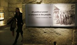 "A quote from the Kansas Constitution hangs in the newly renovated gallery at the Statehouse in Topeka, Kan., Wednesday, Jan. 15, 2014. Gov. Brownback waxed nostalgic Wednesday in his prepared statement, noting new displays in the renovated Statehouse proclaim a line from the Kansas Constitution that ""all political power is inherent to the people."" (AP Photo/Orlin Wagner)"