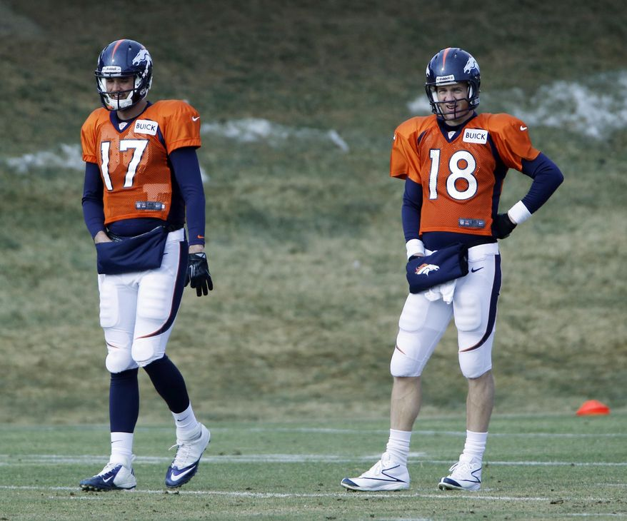 Denver Broncos quarterback Brock Osweiler (17) and Denver Broncos quarterback Peyton Manning (18) wait for the next drill at the NFL Denver Broncos football training facility in Englewood, Colo., on Wednesday, Jan. 15, 2014. The Broncos are scheduled to play the New England Patriots on Sunday for the AFC Championship. (AP Photo/Ed Andrieski)