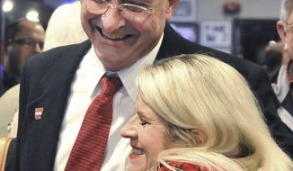 Republican John Cooper (left) hugs Linda Collins-Smith on the night of Tuesday, Jan. 14, 2014, after defeating Democrat Steve Rockwell for the Arkansas District 21 State Senate seat. (AP Photo/The Jonesboro Sun, Rob Holt)