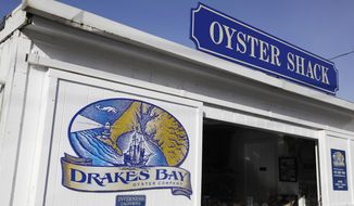 FILE - This Wednesday Nov. 21, 2012, file photo, shows the exterior of an oyster shack at the Drakes Bay Oyster Company in Point Reyes National Seashore, Calif. U.S. The owner of the oyster farm said Wednesday, Jan. 15, 2014, he'll ask the U.S. Supreme Court to hear his case challenging a federal decision not to renew the facility's lease. (AP Photo/Eric Risberg. File)