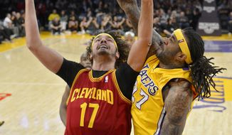 Cleveland Cavaliers center Anderson Varejao, left, of Brazil, puts up a shot as Los Angeles Lakers center Jordan Hill defends during the first half of an NBA basketball game, Tuesday, Jan. 14, 2014, in Los Angeles. (AP Photo/Mark J. Terrill)