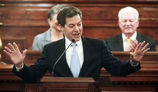 Kansas Gov. Sam Brownback delivers his State of the State address, Wednesday, Jan. 15, 2014, in the House of Representatives in Topeka, Kan. (AP Photo/The Topeka Capital Journal, Chris NeaL)