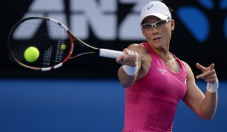 Samantha Stosur of Australia makes a forehand return to Tsvetana Pironkova of Bulgaria during their second round match at the Australian Open tennis championship in Melbourne, Australia, Wednesday, Jan. 15, 2014.(AP Photo/Aaron Favila)