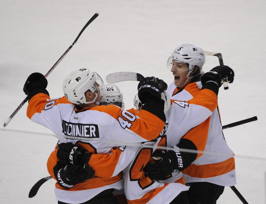 Philadelphia Flyers Vincent Lecavalier (40) celebrates his game-winning goal with Matt Read (24) Kimmo Timonen (44) and Braydon Coburn (5) during the third  period of an NHL hockey game against the Buffalo Sabres in Buffalo, N.Y., Tuesday, Jan. 14, 2014.  Philadelphia won 4-3. (AP Photo/Gary Wiepert)