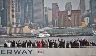 "Survivors of U.S. Airways Flight 1549 with155 passengers and crew, including Captain Chesley ""Sully"" Sullenberger III, who piloted safe water landing 5 years ago, join with their rescuers in a toast marking the anniversary of the event known as the ""miracle on the Hudson,"" on Wednesday, Jan. 15, 2014 in New York.  (AP Photo/Bebeto Matthews)"