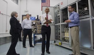 President Barack Obama, accompanied by Energy Secretary Ernest Moniz, left, speaks to the media during a tour of Vacon, a research and development center and lab for high-power AC drives,  Wednesday, Jan. 15, 2014, in Durham, N.C. Vacon Vice President Dan Isaksson is second from left. Afterward, the president traveled to North Carolina State University to speak about the economy, jobs and manufacturing.  (AP Photo/Carolyn Kaster)