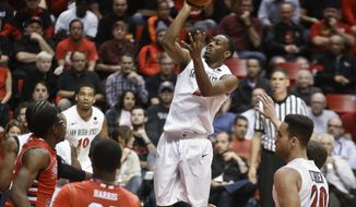 San Diego State guard Xavier Thames puts up a jumper against Fresno State  uring the first half of an NCAA college basketball game Wednesday, Jan. 15, 2014, in San Diego. (AP Photo/Lenny Ignelzi)
